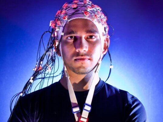 man with eeg cap on head